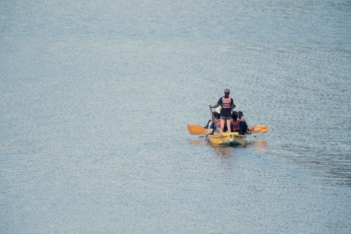 people in yellow boat