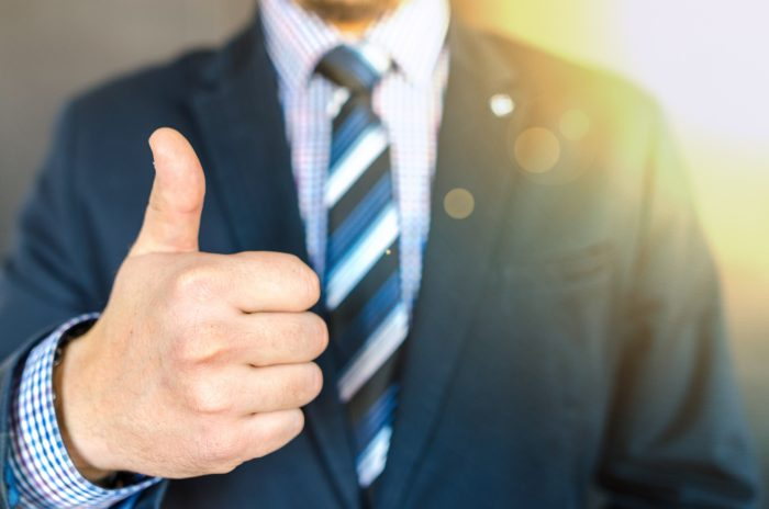 close-up-photo-of-man-wearing-black-suit-jacket-doing-thumbs-684385